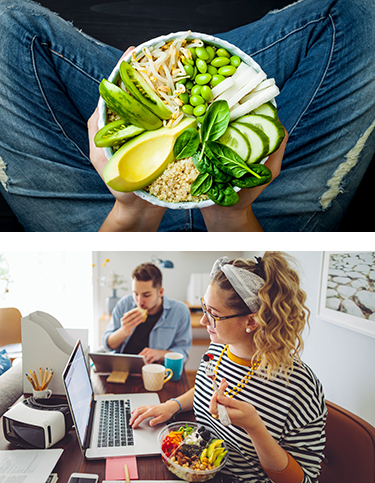 Healthy green salad in lap and young woman eating a salad at a laptop | Newport Institute