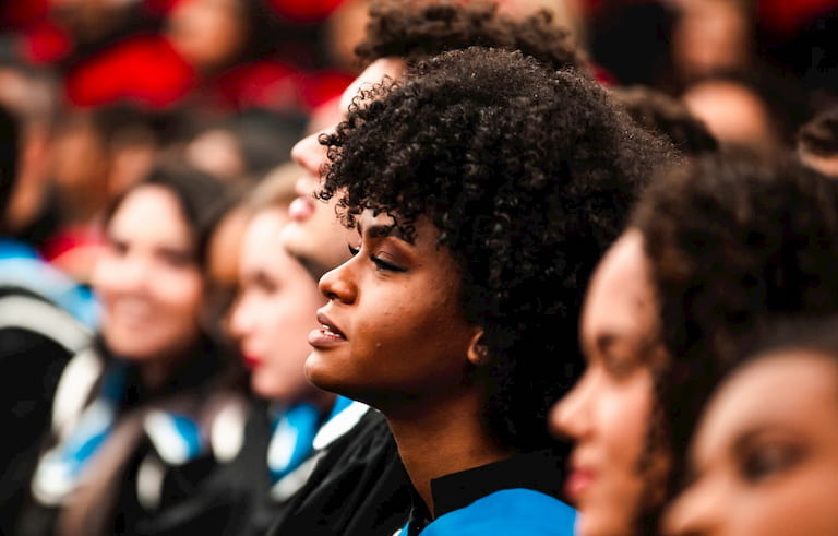 A young woman at graduation | Newport Institute